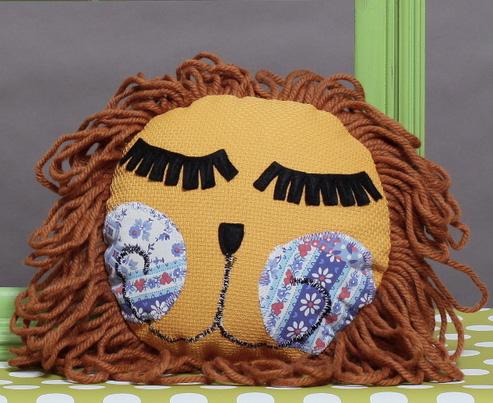 Sleepy Smiley Lion Patchwork Pillow by Twiglet